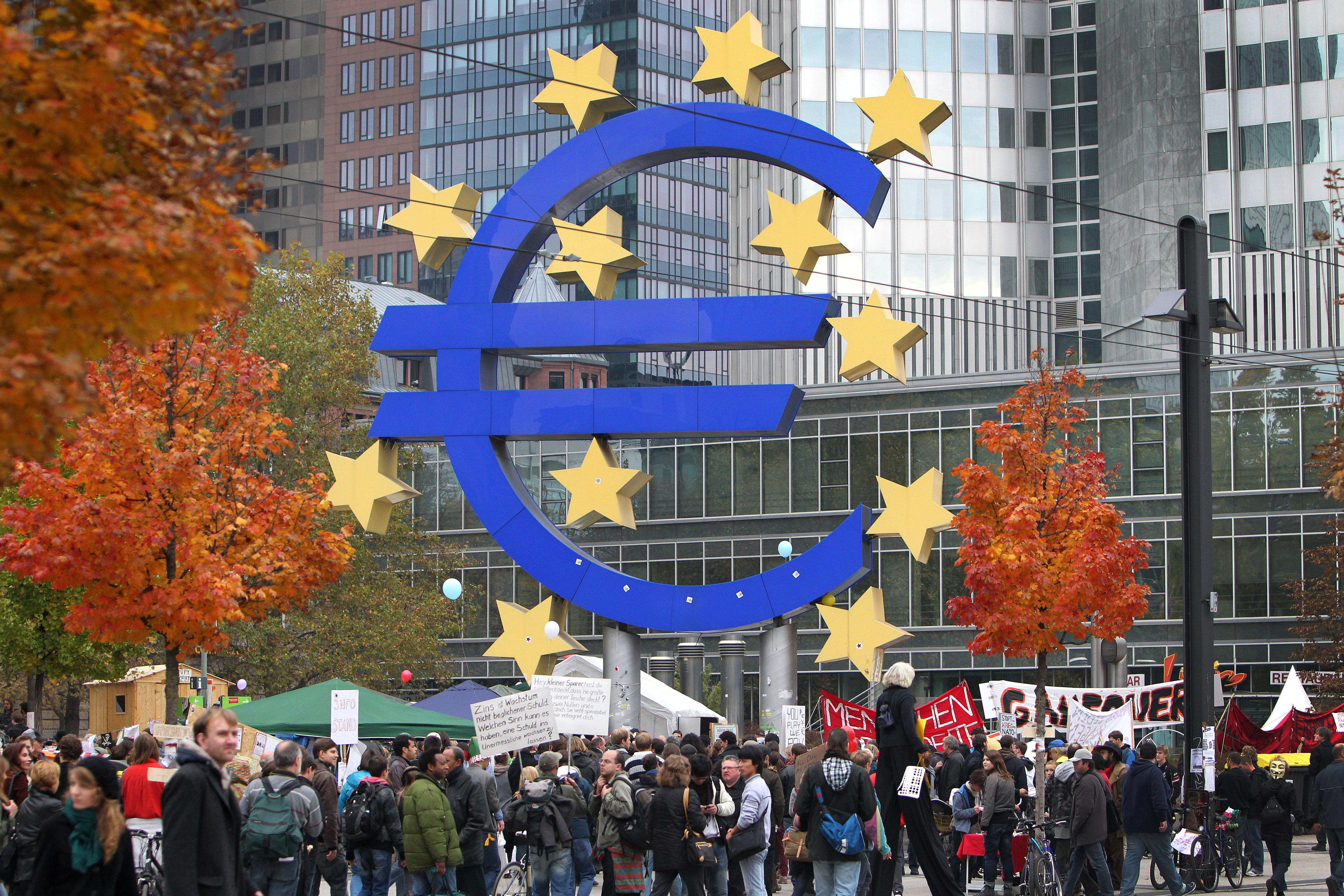 Demonstrators crowd around the euro logo in front of the European Central Bank (ECB) as they take part in a protest march as part of the 'Occupy Frankfurt' movement in Frankfurt am Main, on October 29, 2011