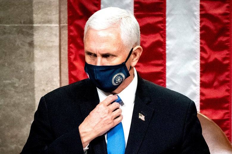 A masked Mike Pence looking stern in front of an American flag.