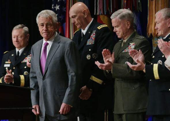 Defense Secretary Chuck Hagel recieves applause after signing the Department of Defense Human Goals Charter on April 28, 2014.