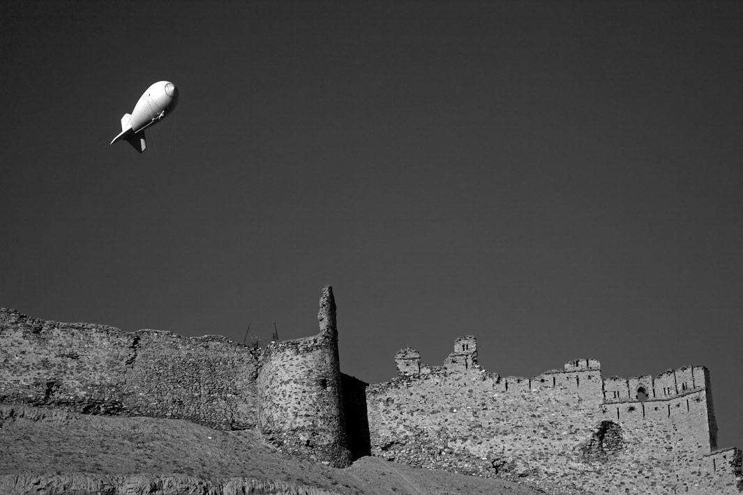 An aerostat balloon carrying out security surveillance  floats over the 5th Century fortress  Bala Hissar in Kabul. Afghanistan on December 2. 2012.
