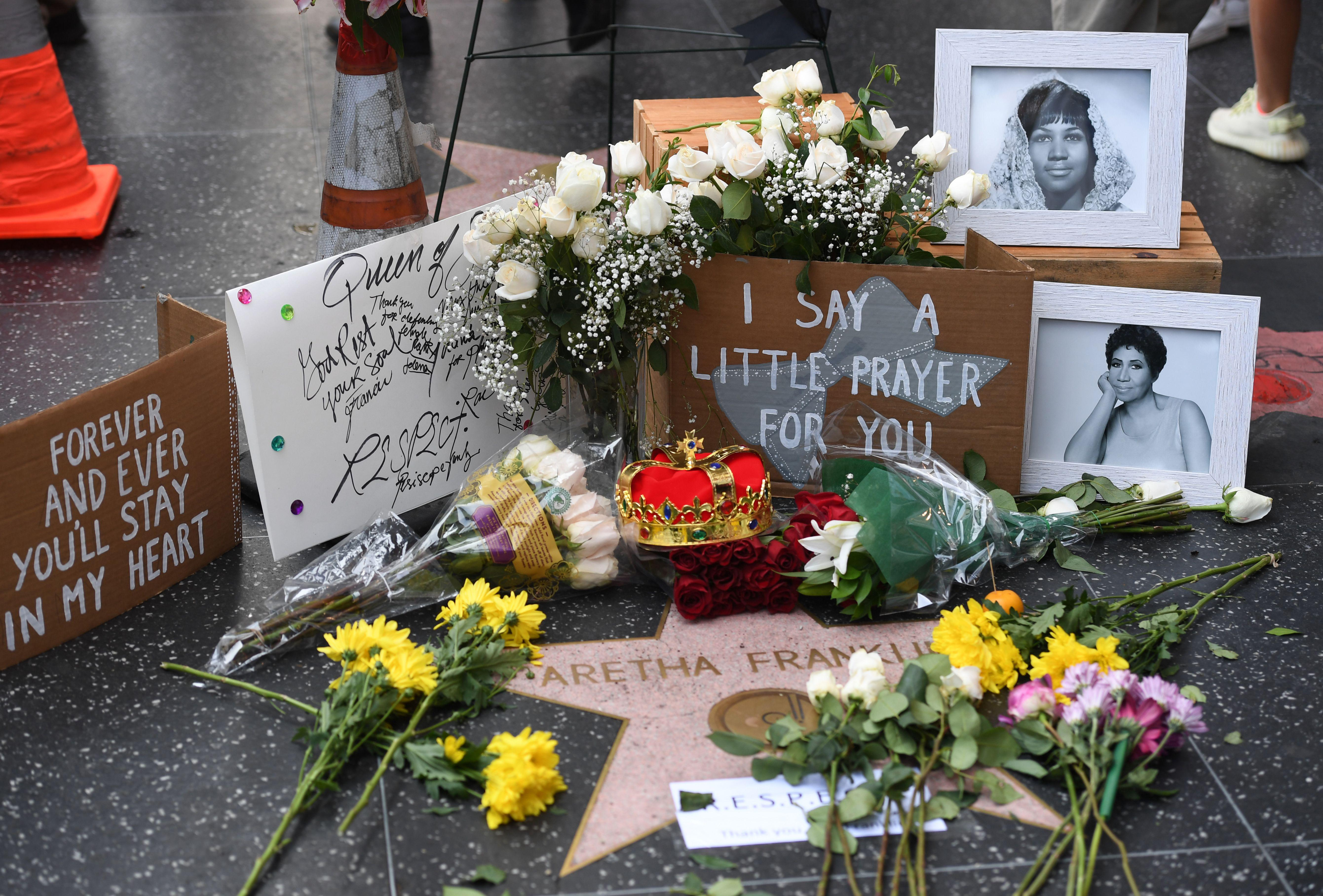 Flowers and tributes are placed on the Star for Aretha Franklin on the Hollywood Walk of Fame in Hollywood, California, August 16, 2018, after the music icon, legendary singer and 'Queen of Soul' loved by millions whose history-making career spanned six decades, died, her longtime publicist announced. - Franklin, who influenced generations of female singers with unforgettable hits including 'Respect' (1967), 'Natural Woman' (1968) and 'I Say a Little Prayer' (1968), passed away August 16, 2018 at home age 76 in Detroit from advanced pancreatic cancer. (Photo by Mark RALSTON / AFP)        (Photo credit should read MARK RALSTON/AFP/Getty Images)