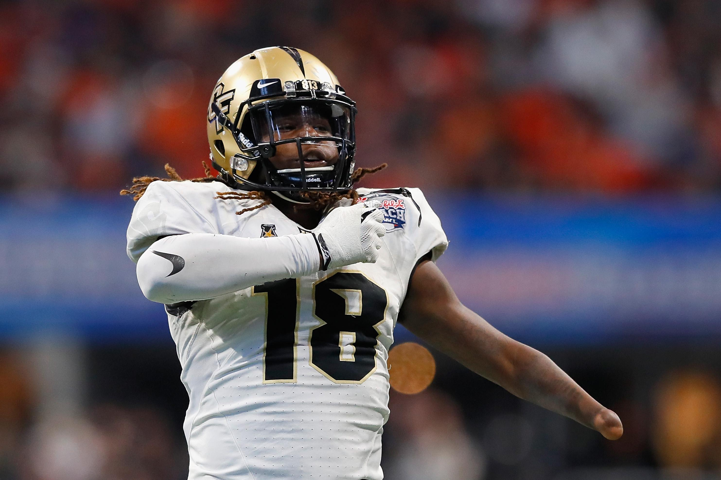 ATLANTA, GA - JANUARY 01:  Shaquem Griffin #18 of the UCF Knights celebrates after sacking Jarrett Stidham #8 of the Auburn Tigers (not pictured) in the second half during the Chick-fil-A Peach Bowl at Mercedes-Benz Stadium on January 1, 2018 in Atlanta, Georgia.  (Photo by Kevin C. Cox/Getty Images)