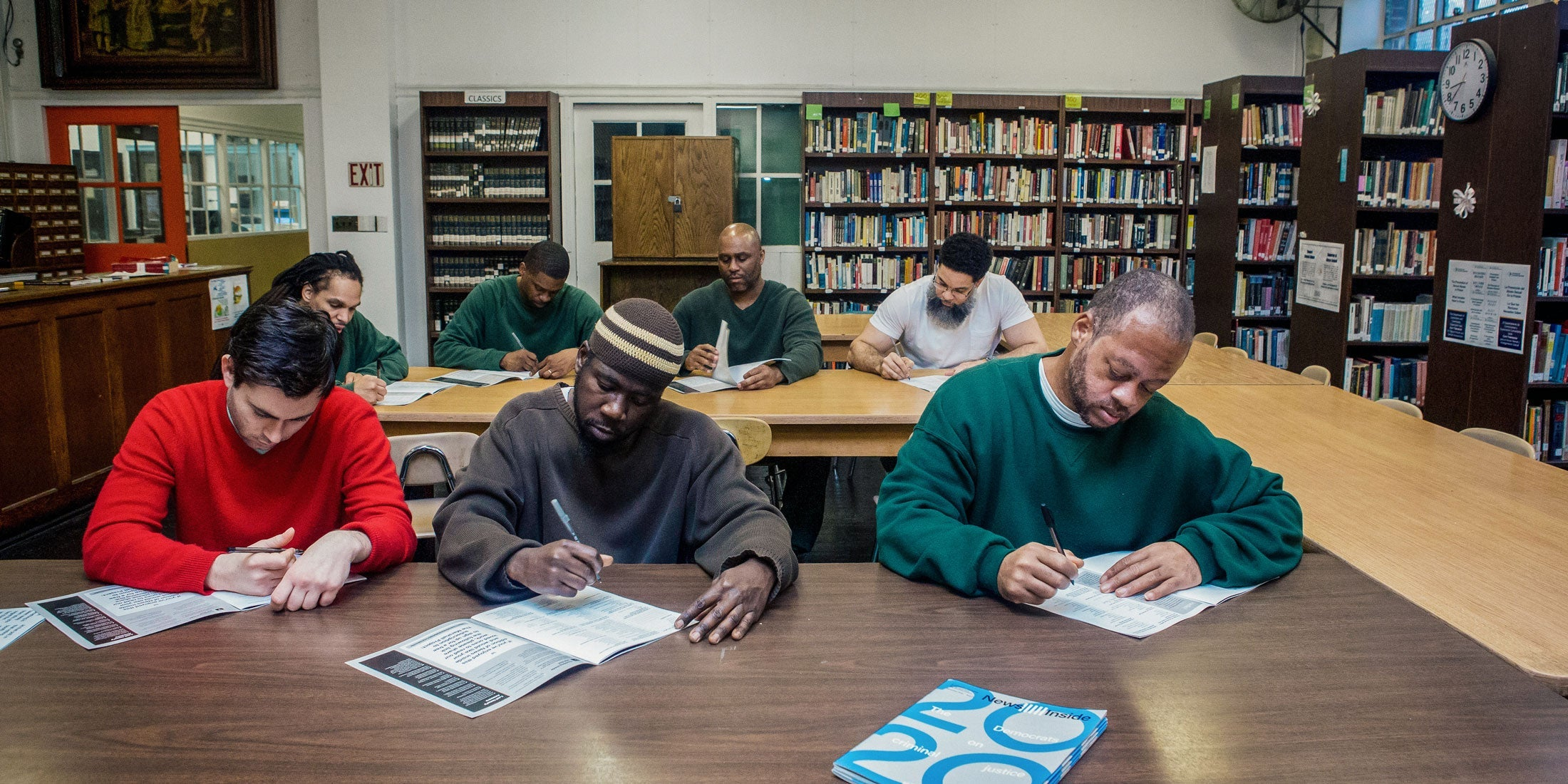 "From left, front row, Hudson Link for Higher Education in Prison students Jacob Nolan, Bryon Brown and Edward Brown fill out the ""News Inside"" political opinion survey at Sing Sing Correctional Facility in Ossining, New York."