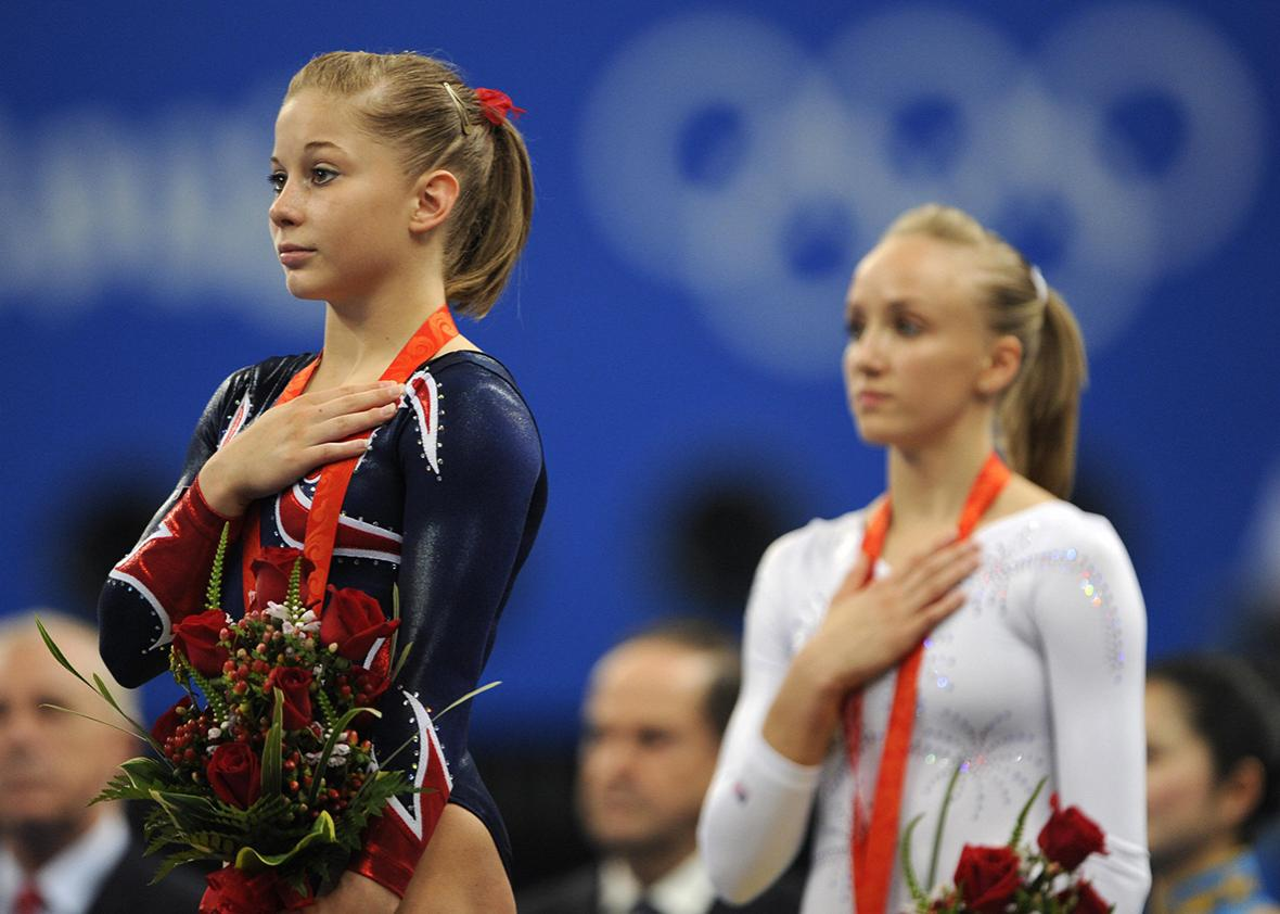 United States' Shawn Johnson and her compatriot United States' Nastia Liukin stand on the podium after the women's balance beam final of the artistic gymnastics event of the Beijing 2008 Olympic Games in Beijing on August 19, 2008.