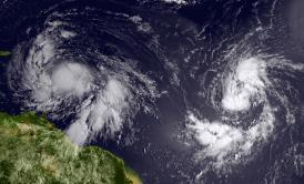 Isaac (left) reached tropical storm status and is approaching the Lesser Antilles islands as it moves westward on Aug. 22, 2012