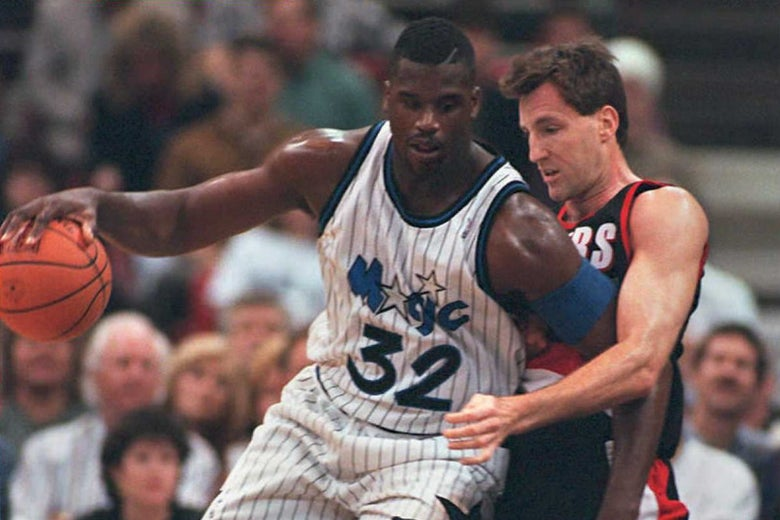 O'Neal, playing for the Orlando Magic against Dudley's Portland Trail Blazers, knocks Dudley backward in the post.