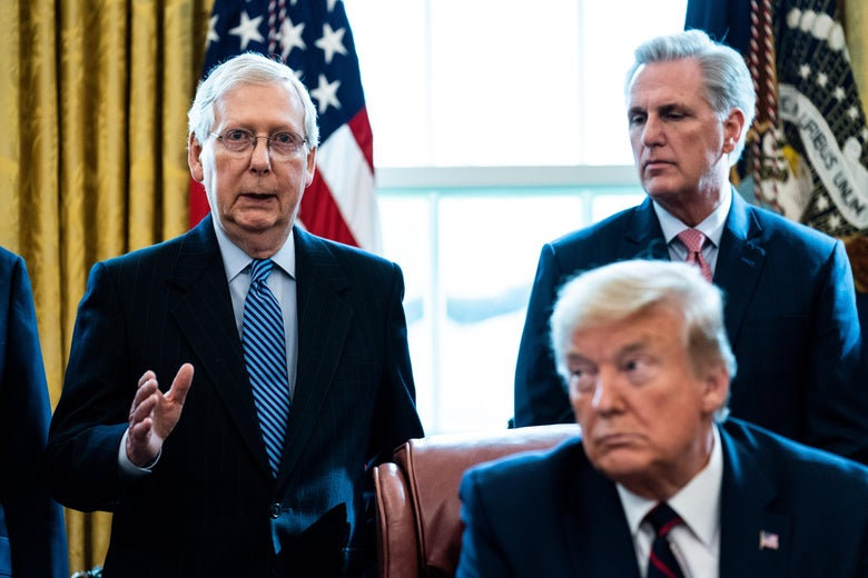 In the Oval Office, Senate Majority Leader Mitch McConnell speaks as House Minority Leader Kevin McCarthy and President Donald Trump listen.