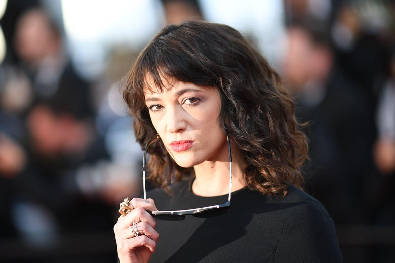 Asia Argento posing with sunglasses lowered