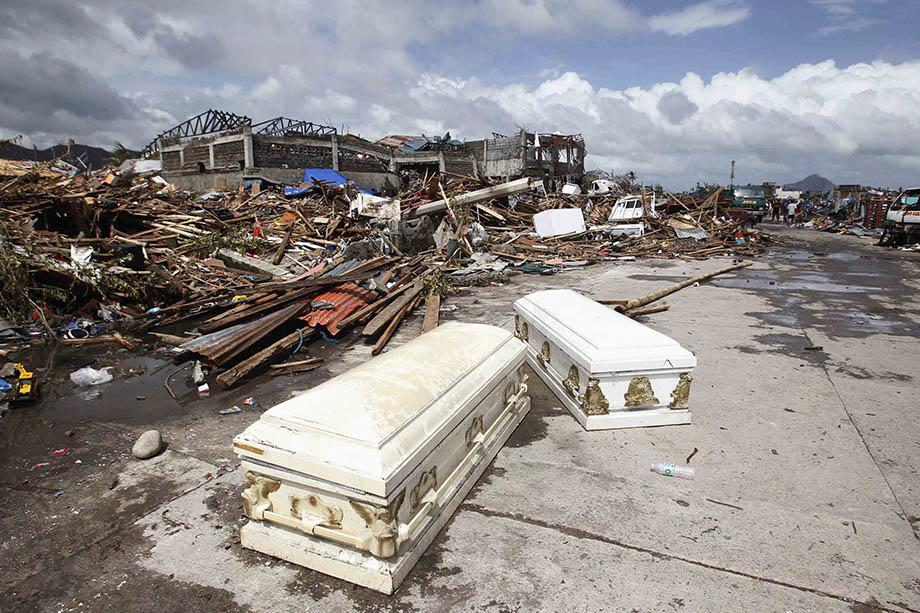Empty coffins lie on a street near houses damaged after super Typhoon Haiyan battered Tacloban city, central Philippines.