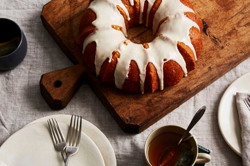 An orange bundt cake with white glaze