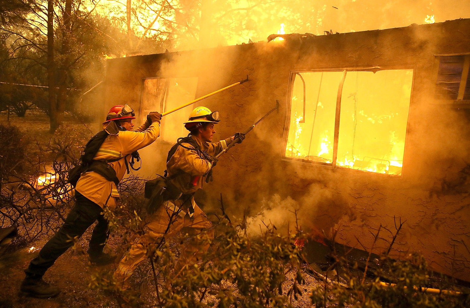 Firefighters try to contain a house on fire in California.