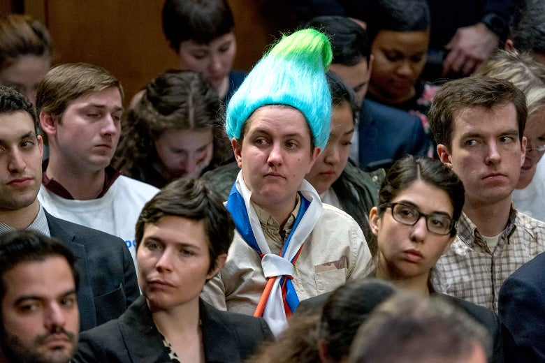 A audience member wearing a blue and green pointy wig, aiming to look like a Russian troll as Facebook CEO Mark Zuckerberg testifies before a joint hearing of the Commerce and Judiciary Committees on Capitol Hill in Washington, Tuesday, April 10, 2018, about the use of Facebook data to target American voters in the 2016 election.