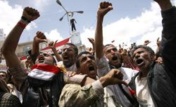 Anti-government protestors show the 'tumbs-down' as they shout demanding the resignation of Yemeni President Ali Abdullah Saleh. Click image to expand.