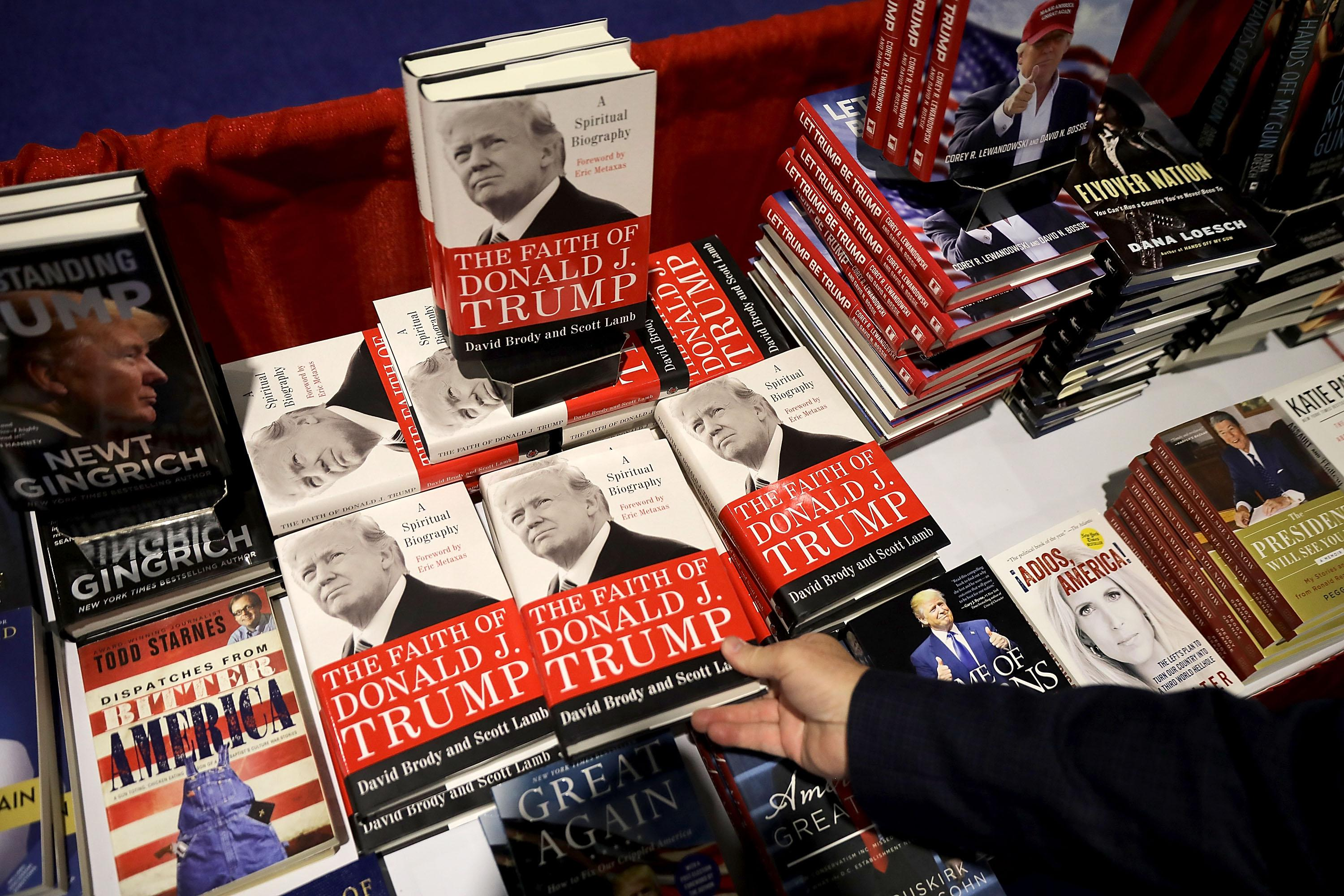 NATIONAL HARBOR, MD - FEBRUARY 23:  Books about Donald Trump and other right wing subjects are for sale inside the Conservative Political Action Conference Hub at the Gaylord National Resort and Convention Center February 23, 2018 in National Harbor, Maryland. Earlier in the day U.S. President Donald Trump addressed CPAC, the largest annual gathering of conservatives in the nation.  (Photo by Chip Somodevilla/Getty Images)