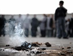 A piece of alleged white phosphorous still burning. Click image to expand.