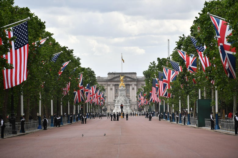 U.S. and U.K. flags leading to Buckingham Palace in central London.