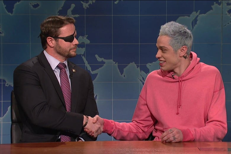Dan Crenshaw shakes hands with Pete Davidson.
