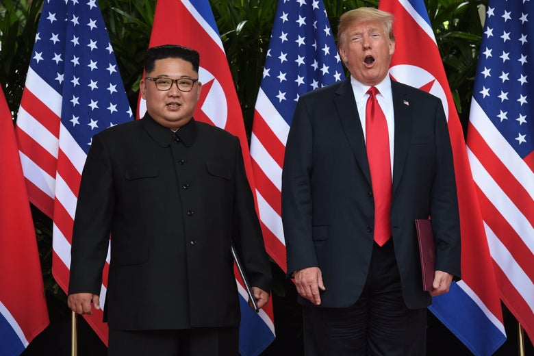 North Korea's Kim Jong-un stands next to President Trump to pose for photos in front of the two countries' flags during the Singapore summit on North Korean nuclear weapons on June 12, 2018.