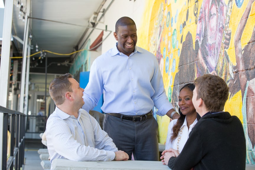 Andrew Gillum talking to voters, as seen in a campaign handout photo.