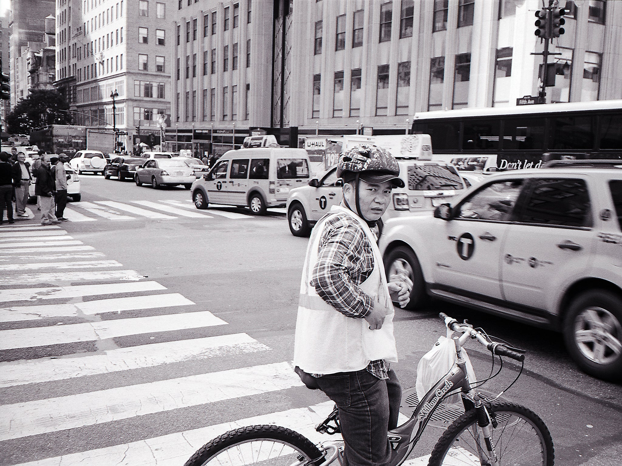 Deliveryman on two wheels, New York.