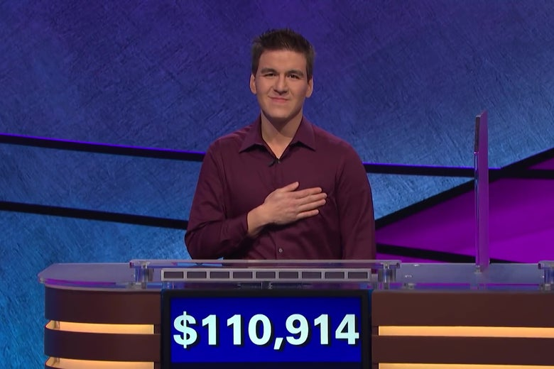James Holzhauer, standing behind a Jeopardy! podium showing $110,914 in winnings.