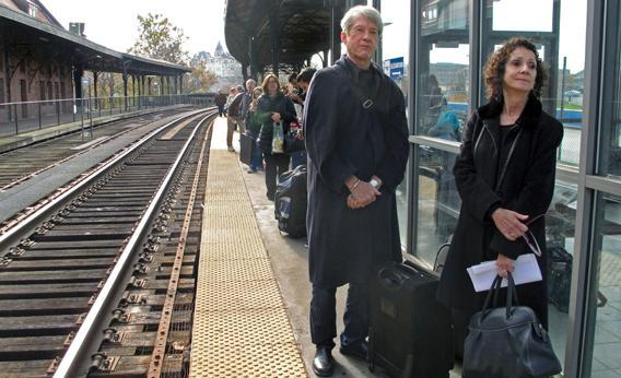 Passengers wait for an Amtrak train to arrive at Union Station in Hartford, Conn.