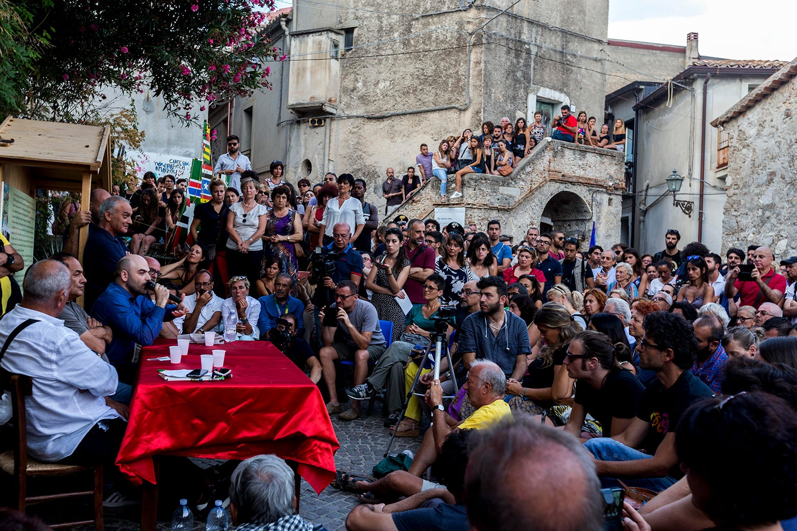 People gathering in the town of Riace.