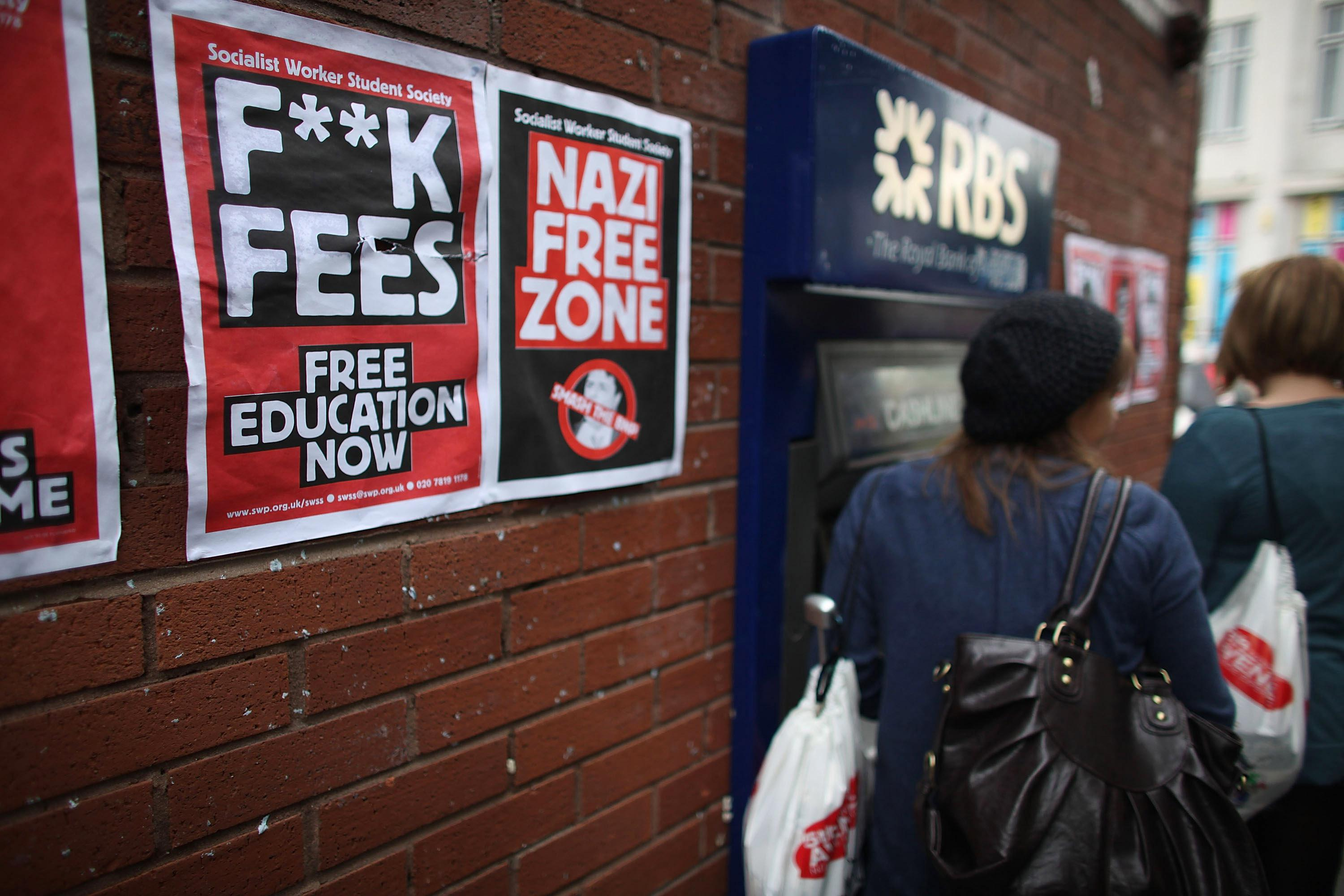 Students arriving for Manchester University's freshers week queue up at a cash machine to draw money on Sept. 22, 2009, in Manchester, England.