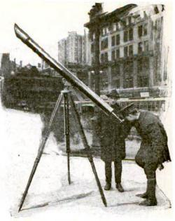 On 42nd street in New York, Joseph G. White shows the new comet or the planets through his 4 1/2 inch refracting telescope, March 1921.