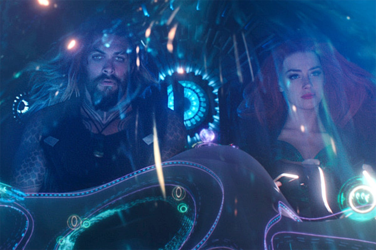 Aquaman and Mera in a ship underwater.