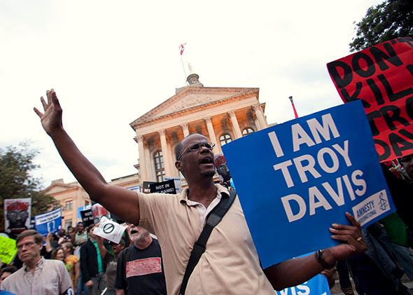 Michael Henry and other protesters for Troy Davis gather on the steps of the Georgia State Capitol in Atlanta on Sept. 20, 2011, the day before Davis' execution