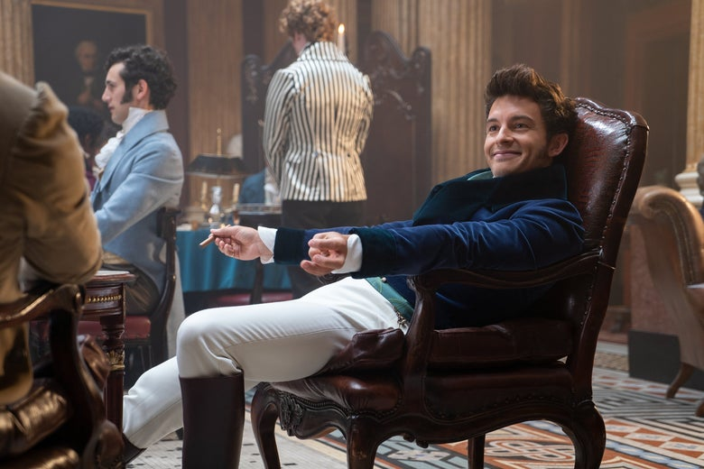 Jonathan Bailey as Anthony Bridgerton slouches in a chair, holding a cigarette.