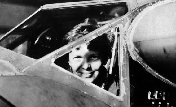 Amelia Earhart looks through the cockpit window of her plane