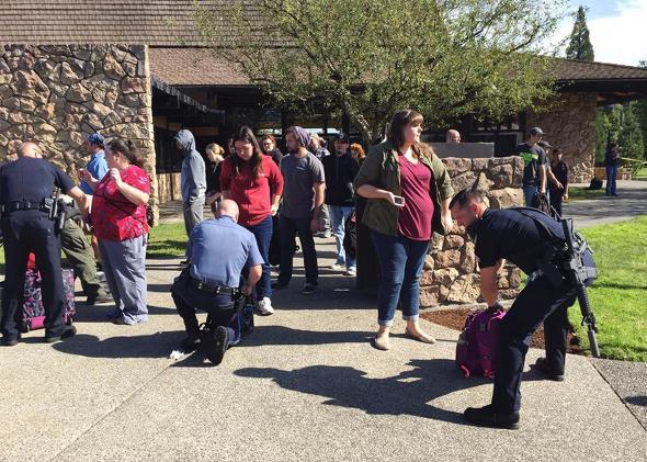 Bag inspection at scene of Shooting Umpqua Community College Ore,Bag inspection at scene of Shooting Umpqua Community College Oregon