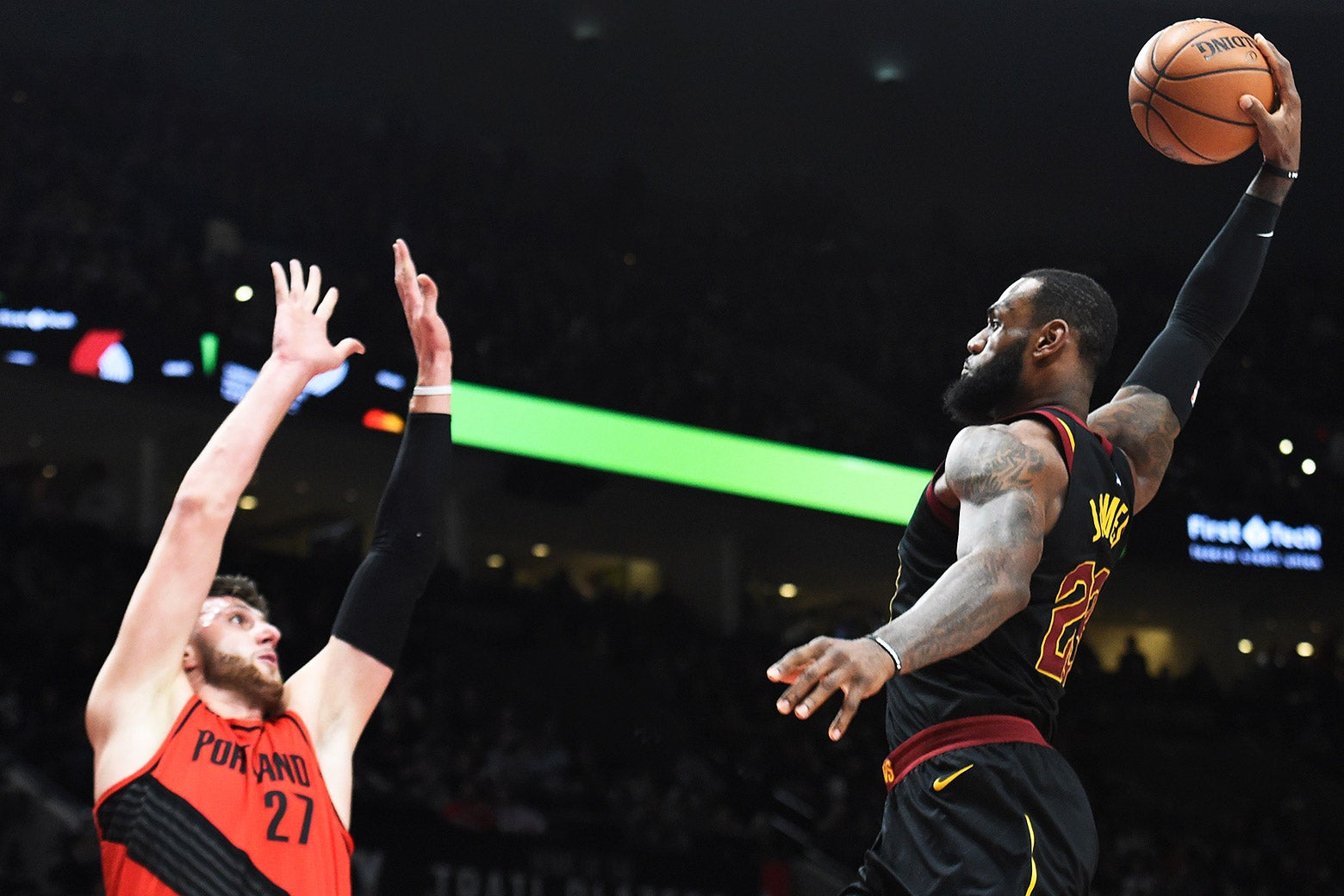 Cleveland Cavaliers forward LeBron James, right, goes up for a dunk on Portland Trail Blazers center Jusuf Nurkic on Thursday, March 15, 2018.