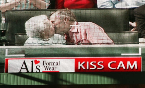 Former President George Bush and his wife, Barbara, caught on the Houston Astros kiss cam, Oct. 16, 2005.