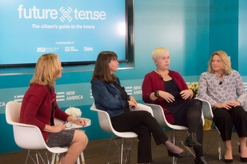 Four women sit in front of a teal wall and a screen with a Future Tense logo.