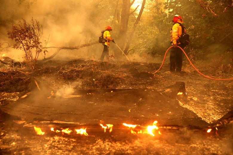 Firefighters extinguish spot fires.