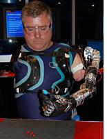 A volunteer uses a foot-controlled prosthesis to pick up and eat an M&M. Click image to expand.