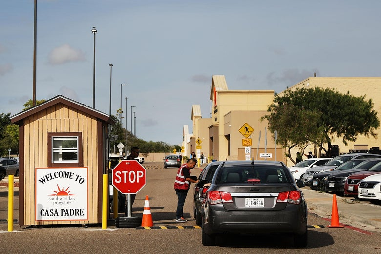 A security guard checks cars at the entrance to Casa Padre, a former Walmart which is now a center for unaccompanied immigrant children in Brownsville, Texas.