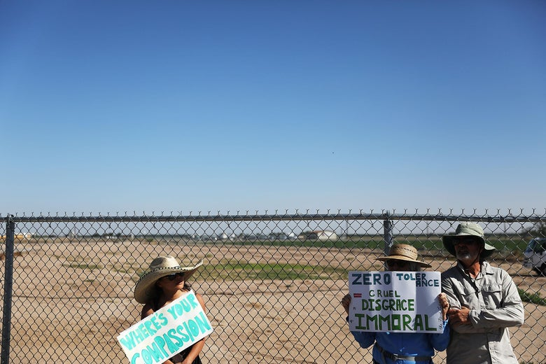 People protest near the tent encampment at the Tornillo-Guadalupe Port of Entry on June 24, 2018 in Tornillo, Texas.