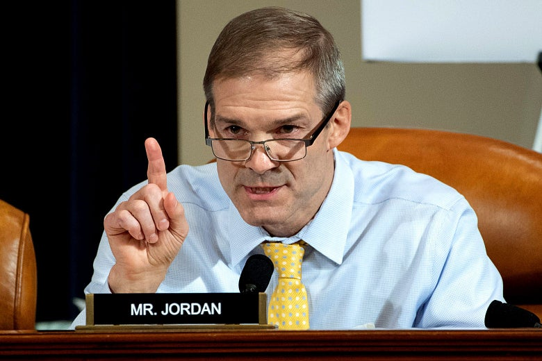Jim Jordan seated behind a desk.
