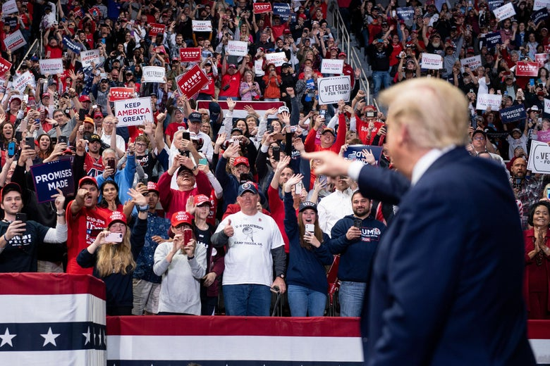 Trump points toward a crowd of his supporters