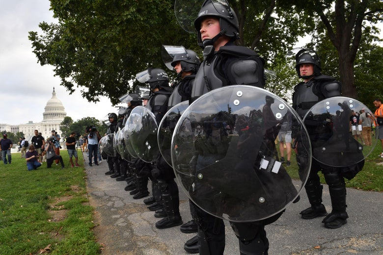 """Police stand guard as demonstrators gather for the """"Justice for J6"""" rally in Washington, D.C. on September 18, 2021."""