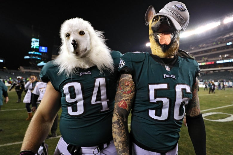 Dog-mask-wearing Beau Allen #94 and Chris Long #56 of the Philadelphia Eagles celebrate their team's win over the Minnesota Vikings.