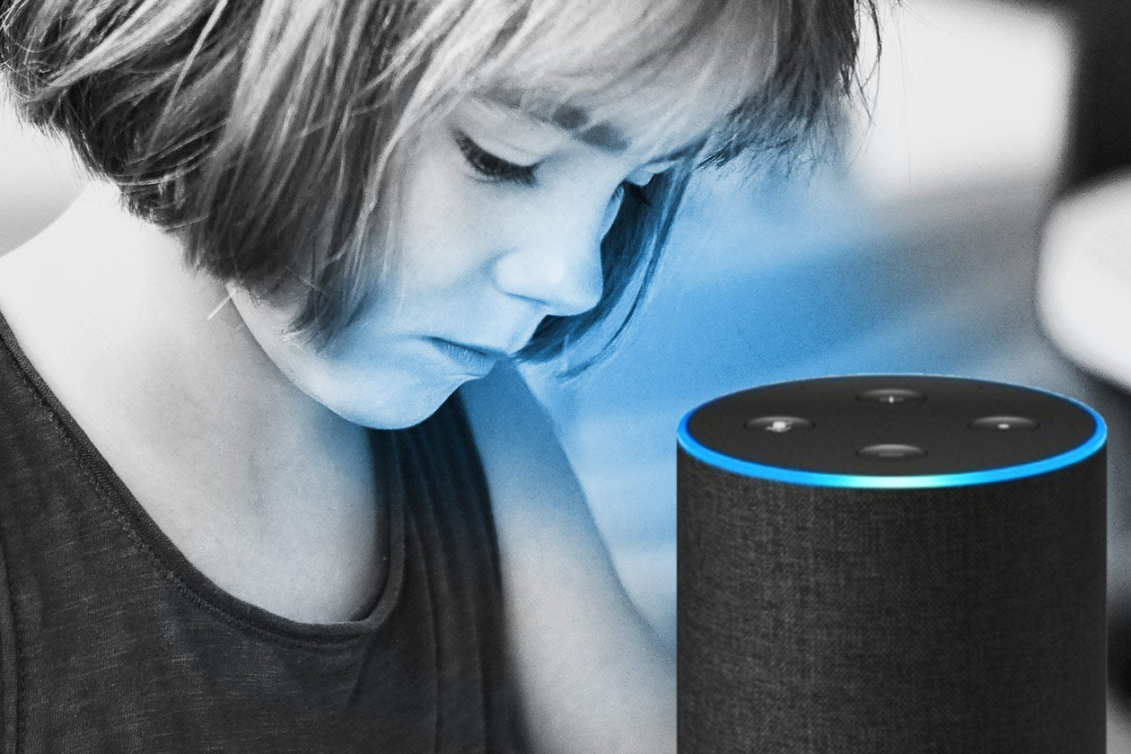 Child looking at an Amazon Echo.