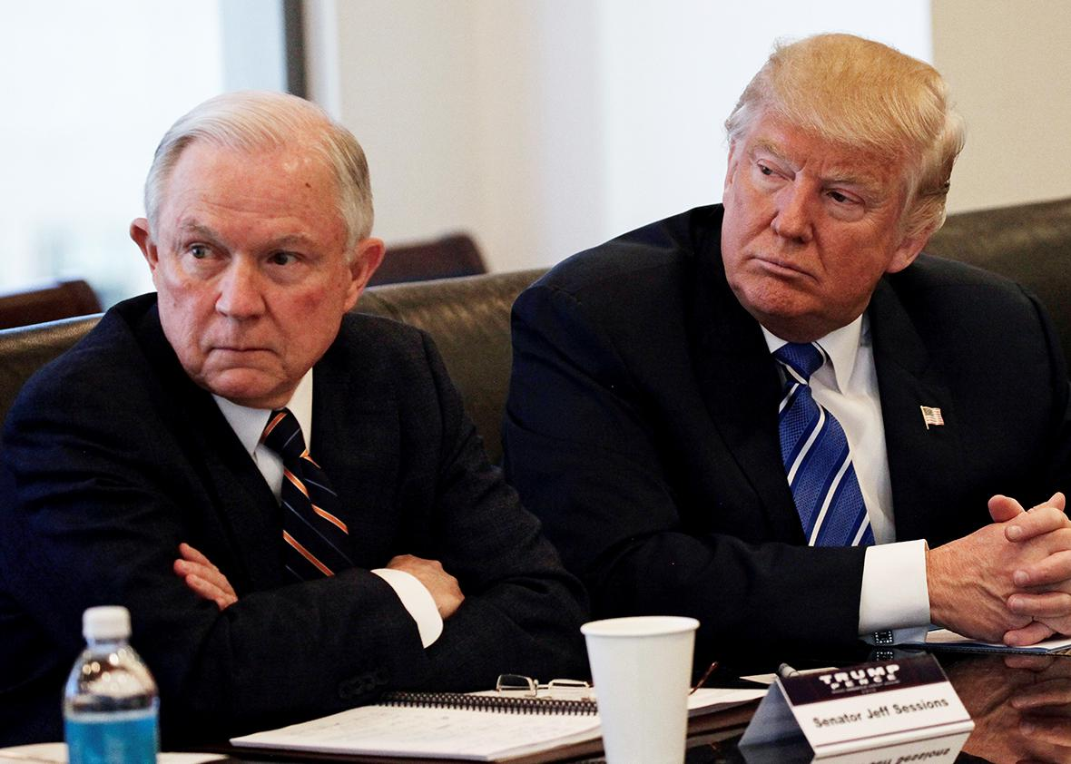 Donald Trump sits with U.S. Senator Jeff Sessions at Trump Tower in Manhattan, New York, U.S., October 7, 2016.
