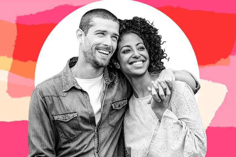 Young multiethnic couple in love isolated on pink background.
