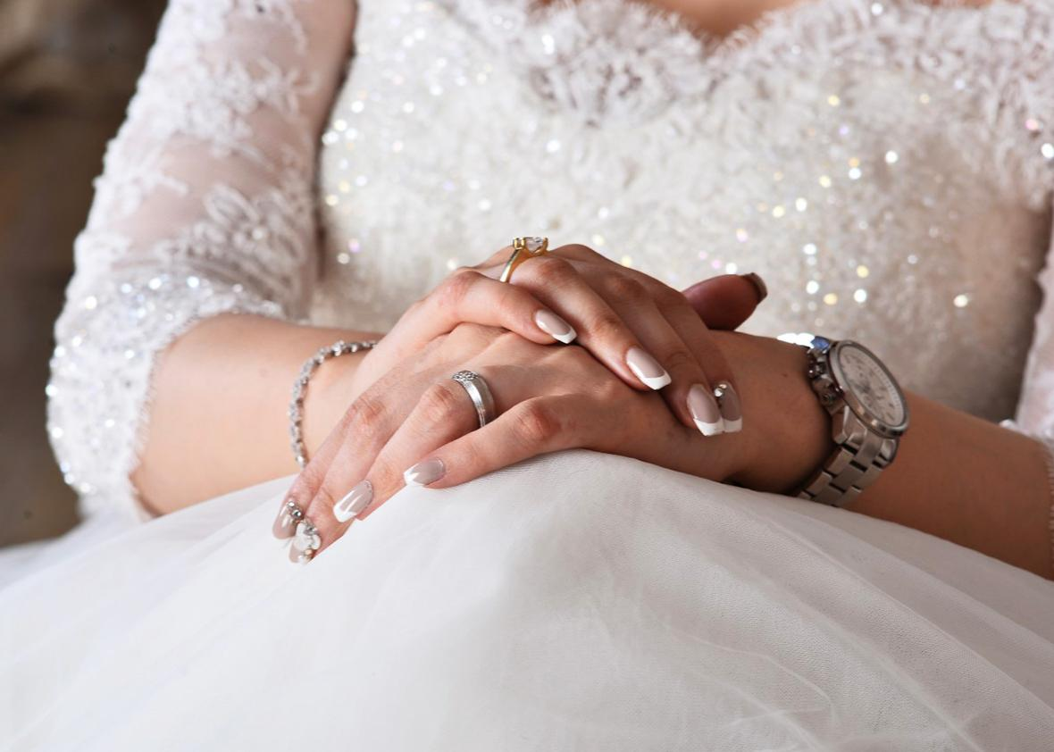 Jewelry (and nails) take center-stage. This is an almost obligatory shot for wedding photographers in Iran.