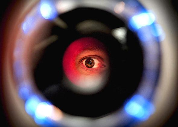 A man uses an iris recognition scanner.